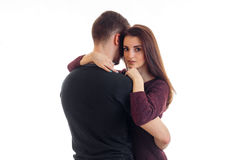 Young guy tenderly embracing a beautiful girl and she looks at the camera Royalty Free Stock Photo