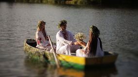 Young guy and three girls swimming in the boat stock video