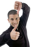 Young guy with thumbs up and down. Against white background Royalty Free Stock Photos