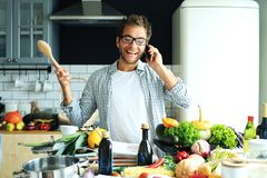 Young guy tries to cook royalty free stock photos