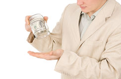A young guy trying to extract money from a glass container Stock Photo