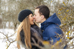 Young guy trying to kiss girl Royalty Free Stock Photo