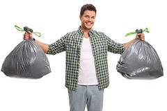 Young guy with two bags of garbage Stock Photography