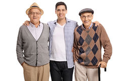 Young guy with two elderly men Stock Image