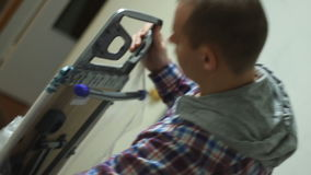 Young guy unpacks ironing board. Slow motion stock video