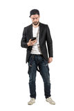 Young guy in unusual clothes holding cellphone Stock Photos