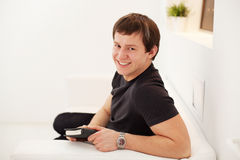 Young guy using diary Stock Photography