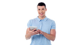Young guy using his tablet pc Stock Images