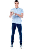 Young guy using his tablet pc Royalty Free Stock Photo