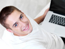 Young guy using laptop Royalty Free Stock Photography