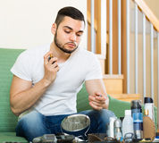 Young guy using perfume at home Royalty Free Stock Photos