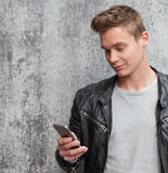 Young guy using smart phone Stock Photography