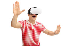 Young guy using virtual reality goggles Stock Images