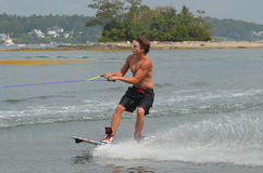 Young Guy Wakeboarding in Casco Bay Maine During the Summer. Summer wakeboarding in Casco Bay Maine Royalty Free Stock Photo