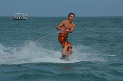 Young Guy Wakeboarding on the Water Off Aruba Royalty Free Stock Photos