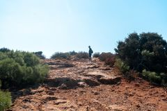 Guy walks on the rocky hills stock photography