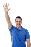 Young guy waving hi to his friend Royalty Free Stock Image