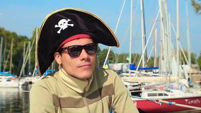 Young guy wearing silly cocked pirate hat, outdoor activities. Stock footage stock footage