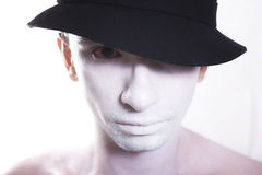 Young guy with white makeup and black hat Royalty Free Stock Photos