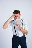 A young guy in a white shirt made a lot of dollars Royalty Free Stock Photos