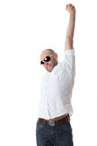 Young guy in white shirt stretch his arms Stock Photography