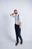 A young guy in a white shirt thinking Royalty Free Stock Photography