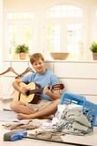 Young guy withguitar Stock Image