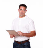 Young guy working with his tablet pc Royalty Free Stock Photography
