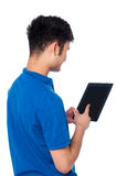 Young guy working on tablet device Stock Images