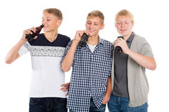Young guys drink beverages Royalty Free Stock Image