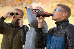 Young guys drink beverages Stock Photography