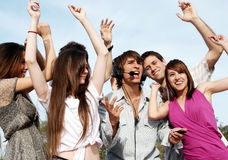 Young guys and girls having fun on the nature Royalty Free Stock Photography