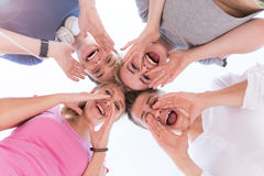 Young guys and girls shouting Royalty Free Stock Images