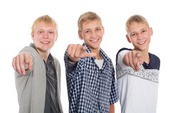 Young guys point fingers forward Stock Images
