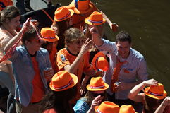 Young guys ride in a boat on the canals of Amsterd Stock Images