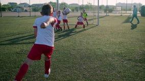 Young guys schoolchildren train football game skills