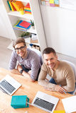 Young guys studying for exams at home Stock Image