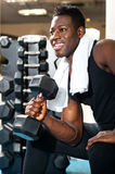 Young gym instructor toning his biceps Stock Photos
