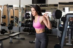 No Pain No Gain. Young gym lover exercising with determination to achieve perfect body royalty free stock photos