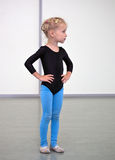 Young gymnast. Little gymnast girl standing in gym stock image