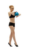 Young gymnast dance with ball in black Royalty Free Stock Photography