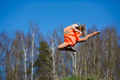Young gymnast doing exercises Royalty Free Stock Photos