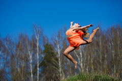 Young gymnast doing exercises Royalty Free Stock Photography