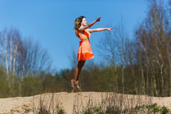 Young gymnast doing exercises Stock Images