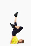 Young gymnast exercising on white Royalty Free Stock Photography