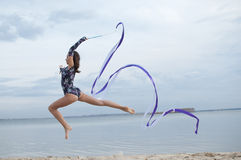 Young gymnast girl dance with ribbon Stock Photography
