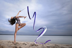 Young gymnast girl dance with ribbon Stock Photos