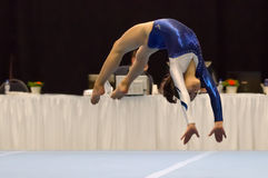 Young gymnast girl performing floor exercise Stock Photos