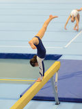 Young gymnast girl performing routine on balance beam Stock Photo