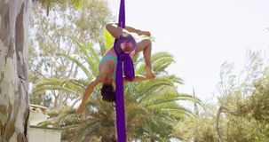 Young gymnast performing an acrobatic dance stock footage